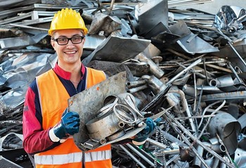 Smiling Worker in Metal Landfill